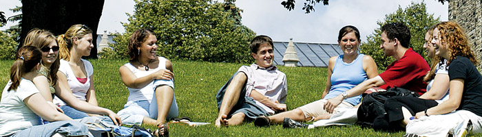 Students sitting on the campus lawn
