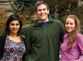 Three undergraduate students smiling