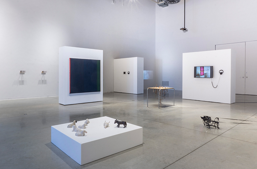 Installation view of exhibition showing a variety of sculptural and wall works