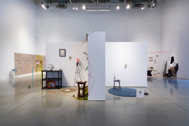 Installation image of a group exhibition of readymade-based collaborations exploring culture