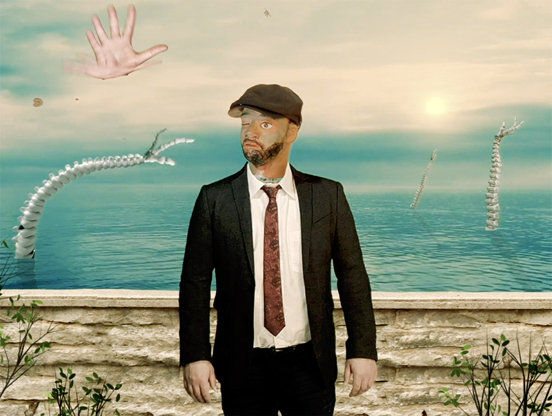A computer generated scene showing a man in a suit with a distorted face standing in front of a body of water, with suspended verterbre in the background